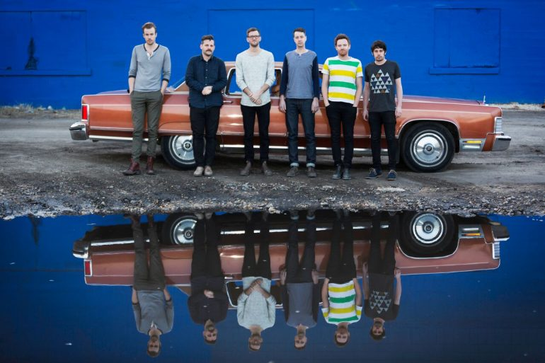 Royal Canoe in front of a car. Photo credit Bill Acheson
